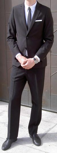 svart kostym begravning